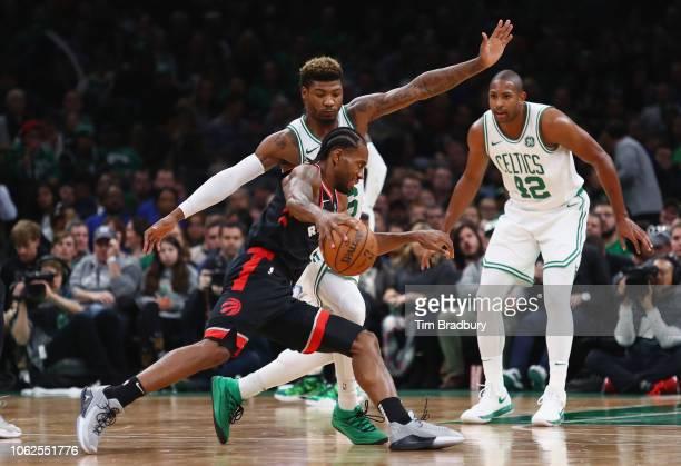 Kawhi Leonard of the Toronto Raptors dribbles the ball against Marcus Smart of the Boston Celtics during the second half at TD Garden on November 16...