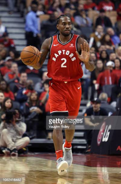 Kawhi Leonard of the Toronto Raptors dribbles the ball during the second half of the NBA season opener against the Cleveland Cavaliers at Scotiabank...