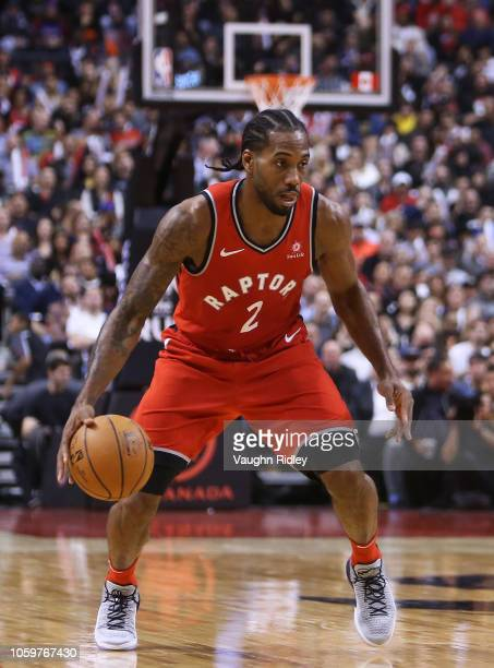 Kawhi Leonard of the Toronto Raptors dribbles the ball during the second half of an NBA game against the Minnesota Timberwolves at Scotiabank Arena...