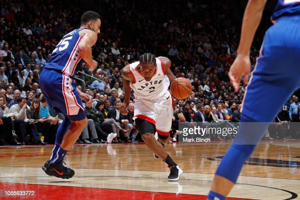 Kawhi Leonard of the Toronto Raptors drives to the basket against the Philadelphia 76ers on October 30 2018 at Soctiabank Arena in Toronto Ontario...