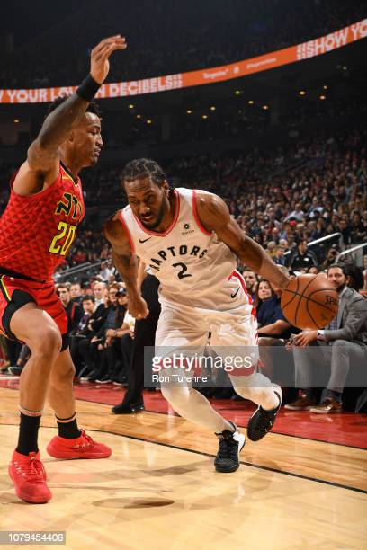 Kawhi Leonard of the Toronto Raptors drives to the basket past John Collins of the Atlanta Hawks on January 8 2019 at the Scotiabank Arena in Toronto...