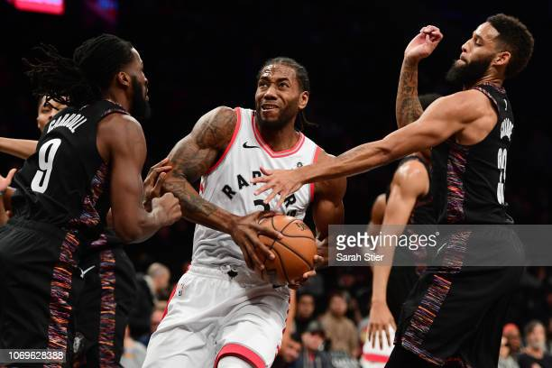 Kawhi Leonard of the Toronto Raptors drives toward the basket during the game against Brooklyn Nets at Barclays Center on December 7 2018 in the...