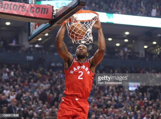 Kawhi Leonard of the Toronto Raptors dunks in the first quarter against the Philadelphia 76ers at Scotiabank Arena on December 5 2018 in Toronto...