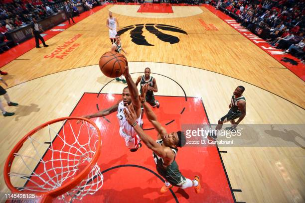 Kawhi Leonard of the Toronto Raptors dunks the ball against Giannis Antetokounmpo of the Milwaukee Bucks during Game Four of the Eastern Conference...