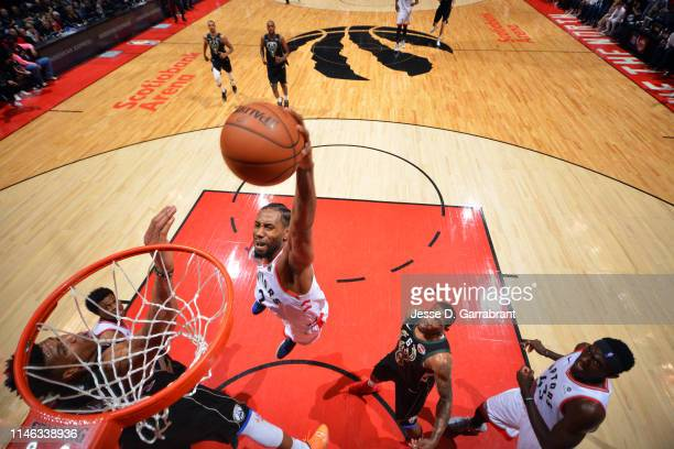 Kawhi Leonard of the Toronto Raptors dunks the ball against the Milwaukee Bucks during Game Six of the Eastern Conference Finals on May 25 2019 at...