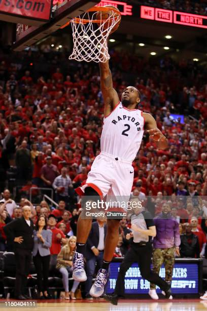 Kawhi Leonard of the Toronto Raptors dunks the ball during overtime against the Milwaukee Bucks in game three of the NBA Eastern Conference Finals at...