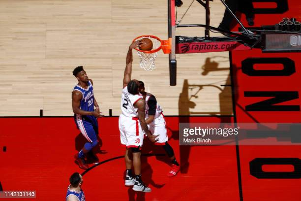 Kawhi Leonard of the Toronto Raptors dunks the ball during the game against the Philadelphia 76ers during Game Five of the Eastern Conference...
