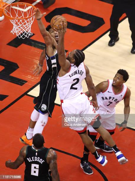 Kawhi Leonard of the Toronto Raptors dunks the ball during the second half against Giannis Antetokounmpo of the Milwaukee Bucks in game six of the...