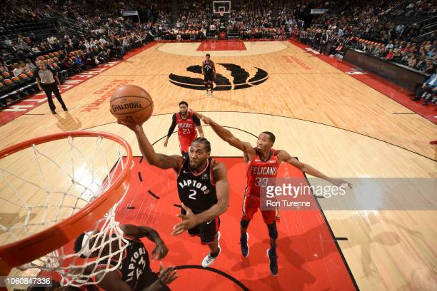 Kawhi Leonard of the Toronto Raptors goes to the basket against the New Orleans Pelicans on November 12 2018 at Scotiabank Arena in Toronto Ontario...