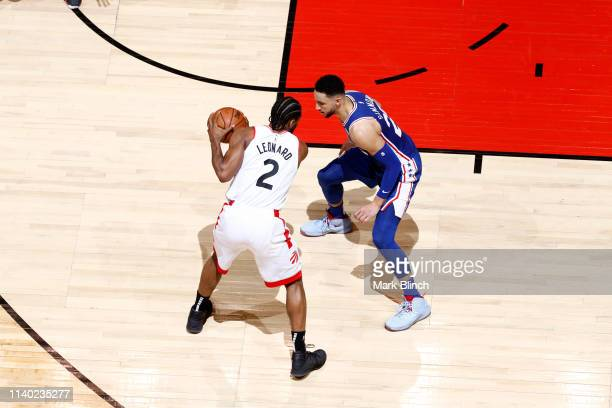 Kawhi Leonard of the Toronto Raptors handles the ball against Ben Simmons of the Philadelphia 76ers during Game Two of the Eastern Conference...