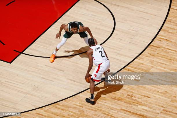 Kawhi Leonard of the Toronto Raptors handles the ball against Giannis Antetokounmpo of the Milwaukee Bucks during Game Four of the Eastern Conference...