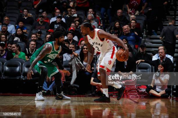 Kawhi Leonard of the Toronto Raptors handles the ball against Kyrie Irving of the Boston Celtics on October 19 2018 at the Air Canada Centre in...