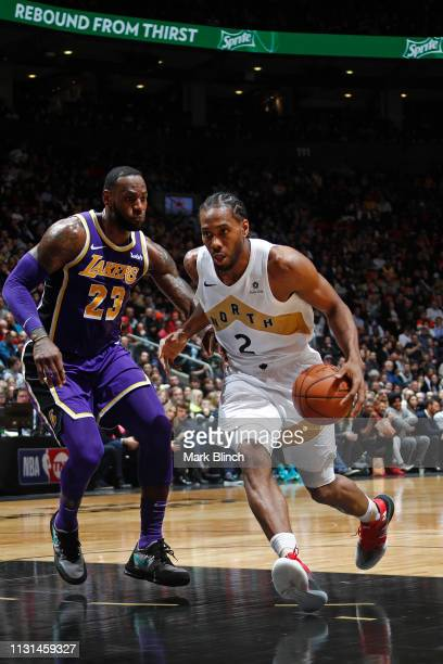 Kawhi Leonard of the Toronto Raptors handles the ball against LeBron James of the Los Angeles Lakers on March 14 2019 at the Scotiabank Arena in...