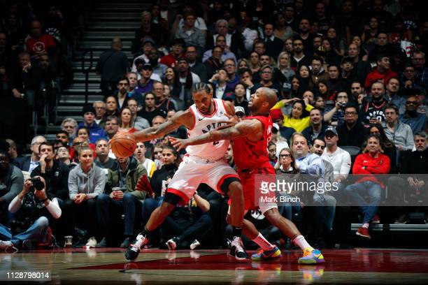 Kawhi Leonard of the Toronto Raptors handles the ball against PJ Tucker of the Houston Rockets on March 5 2019 at Scotiabank Arena in Toronto Ontario...