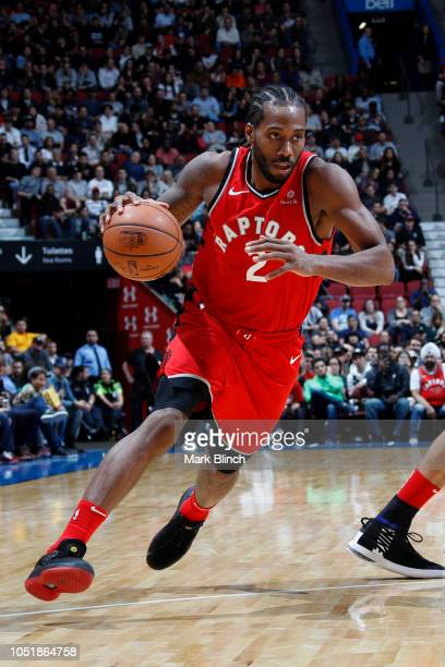 Kawhi Leonard of the Toronto Raptors handles the ball against the Brooklyn Nets during a preseason game on October 10 2018 at Bell Centre in Montreal...