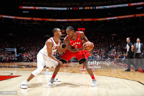 Kawhi Leonard of the Toronto Raptors handles the ball against the Cleveland Cavaliers on October 17 2018 at Scotiabank Arena in Toronto Ontario...