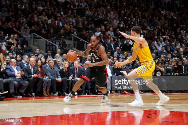 Kawhi Leonard of the Toronto Raptors handles the ball against the Golden State Warriors on November 29 2018 at Scotiabank Arena in Toronto Ontario...