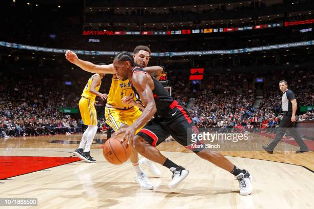 Kawhi Leonard of the Toronto Raptors handles the ball against the Golden State Warriors on November 29 2018 at the Scotiabank Arena in Toronto...