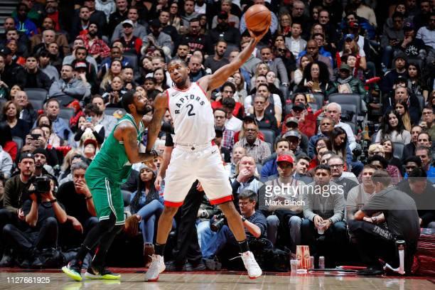 Kawhi Leonard of the Toronto Raptors handles the ball against the Boston Celtics on February 26 2019 at the Scotiabank Arena in Toronto Ontario...