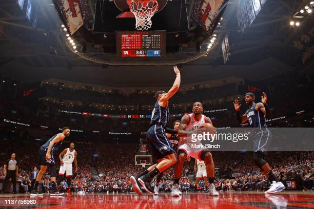 Kawhi Leonard of the Toronto Raptors handles the ball against the Orlando Magic during Game Two of Round One of the 2019 NBA Playoffs on April 16...