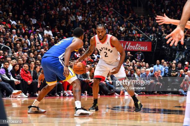 Kawhi Leonard of the Toronto Raptors handles the ball against the Golden State Warriors during Game One of the NBA Finals on May 30 2019 at...