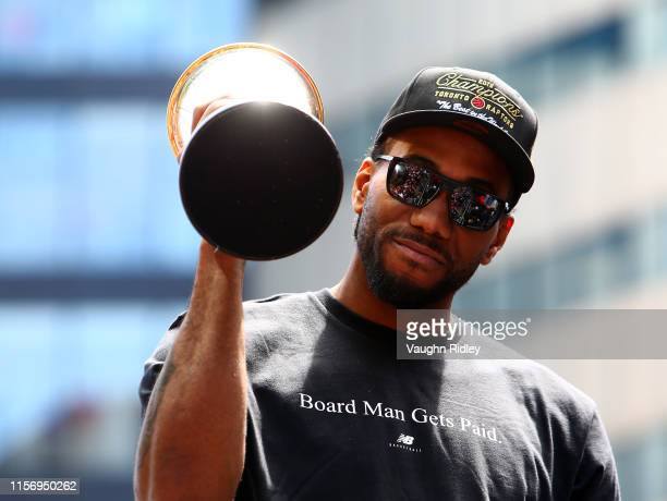 Kawhi Leonard of the Toronto Raptors holds the MVP trophy during the Toronto Raptors Victory Parade on June 17, 2019 in Toronto, Canada. The Toronto...