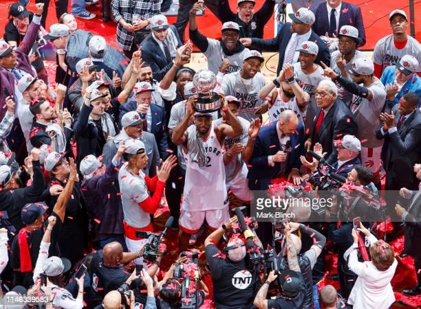 Kawhi Leonard of the Toronto Raptors holds up the Eastern Conference Finals Trophy after Game Six of the Eastern Conference Finals against the...