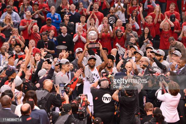 Kawhi Leonard of the Toronto Raptors holds up the Eastern Conference Championship trophy after a game against the Milwaukee Bucks after Game Six of...