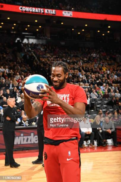 Kawhi Leonard of the Toronto Raptors is presented his 2019 All Star ball prior to the game against the Washington Wizards on February 13 2019 at the...