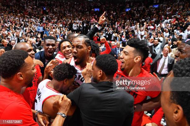 Kawhi Leonard of the Toronto Raptors reacts after defeating the Philadelphia 76ers in Game Seven of the Eastern Conference SemiFinals of the 2019 NBA...