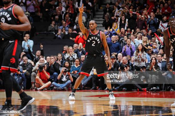 Kawhi Leonard of the Toronto Raptors reacts against the Golden State Warriors on November 29 2018 at the Scotiabank Arena in Toronto Ontario Canada...