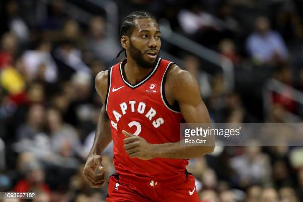 Kawhi Leonard of the Toronto Raptors runs down the floor in the first half against the Washington Wizards at Capital One Arena on January 13 2019 in...