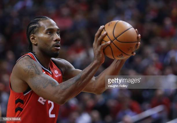 Kawhi Leonard of the Toronto Raptors shoots a free throw during the second half of the NBA season opener against the Cleveland Cavaliers at...