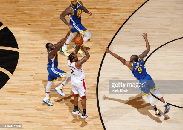 Kawhi Leonard of the Toronto Raptors shoots a three point basket against the Golden State Warriors during Game Five of the NBA Finals on June 10,...