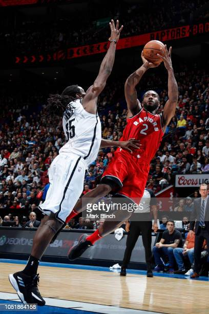 Kawhi Leonard of the Toronto Raptors shoots the ball against the Brooklyn Nets during a preseason game on October 10 2018 at Bell Centre in Montreal...