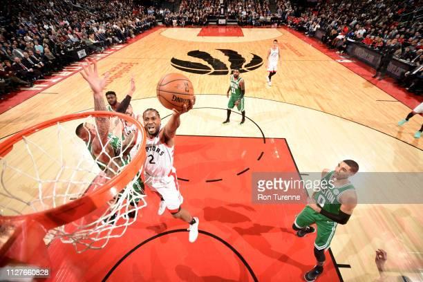 Kawhi Leonard of the Toronto Raptors shoots the ball against the Boston Celtics on February 26 2019 at the Scotiabank Arena in Toronto Ontario Canada...