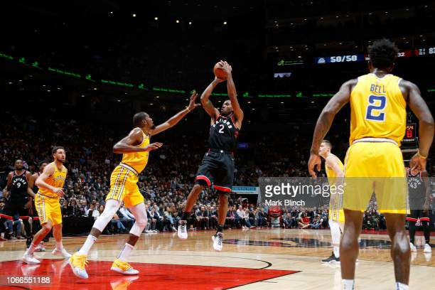 Kawhi Leonard of the Toronto Raptors shoots the ball against the Golden State Warriors on November 29 2018 at Scotiabank Arena in Toronto Ontario...