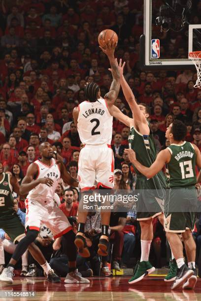 Kawhi Leonard of the Toronto Raptors shoots the ball against the Milwaukee Bucks during Game Four of the Eastern Conference Finals on May 21 2019 at...