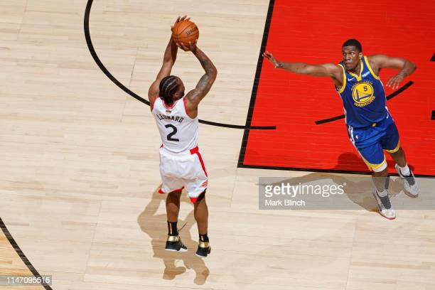 Kawhi Leonard of the Toronto Raptors shoots the ball against the Golden State Warriors during Game One of the NBA Finals on May 30 2019 at Scotiabank...