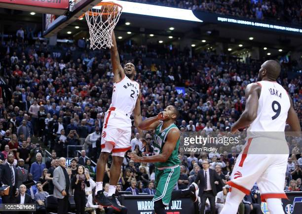 Kawhi Leonard of the Toronto Raptors shoots the ball as Al Horford of the Boston Celtics defends during the second half of an NBA game at Scotiabank...