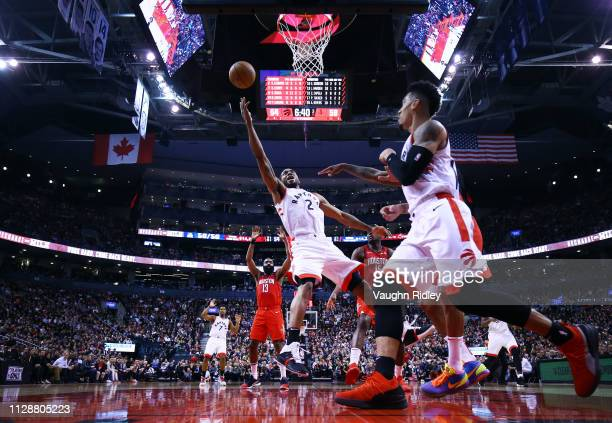 Kawhi Leonard of the Toronto Raptors shoots the ball as PJ Tucker of the Houston Rockets defends during the second half of an NBA game at Scotiabank...