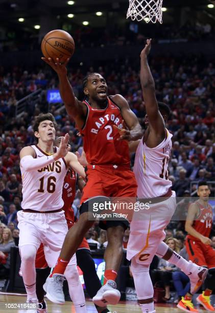 Kawhi Leonard of the Toronto Raptors shoots the ball as Tristan Thompson of the Cleveland Cavaliers defends during the second half of the NBA season...