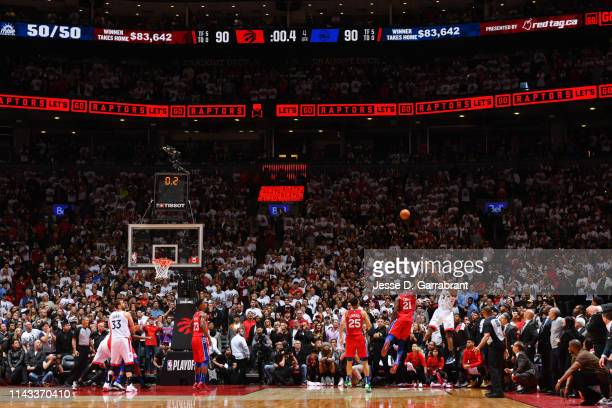 Kawhi Leonard of the Toronto Raptors shoots the ball to win the game against the Philadelphia 76ers during Game Seven of the Eastern Conference...
