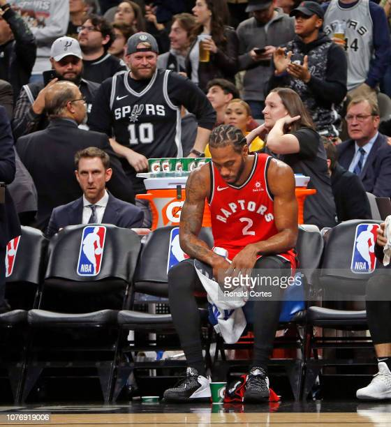 Kawhi Leonard of the Toronto Raptors sits on the bench during a timeout against the San Antonio Spurs at ATT Center on January 3 2019 in San Antonio...