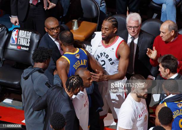 Kawhi Leonard of the Toronto Raptors talks to Kevin Durant of the Golden State Warriors after sustaining an injury during Game Five of the NBA Finals...