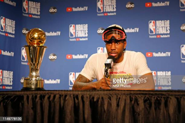 Kawhi Leonard of the Toronto Raptors talks to the media during a press conference with the Larry O'Brien Trophy after Game Six of the NBA Finals...