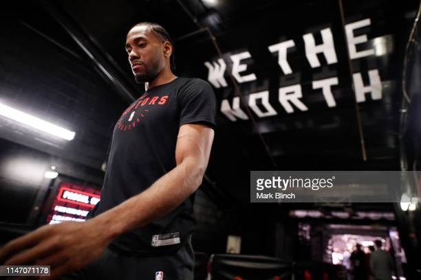 Kawhi Leonard of the Toronto Raptors walks off the court after warming up before Game One of the NBA Finals against the Golden State Warriors on May...
