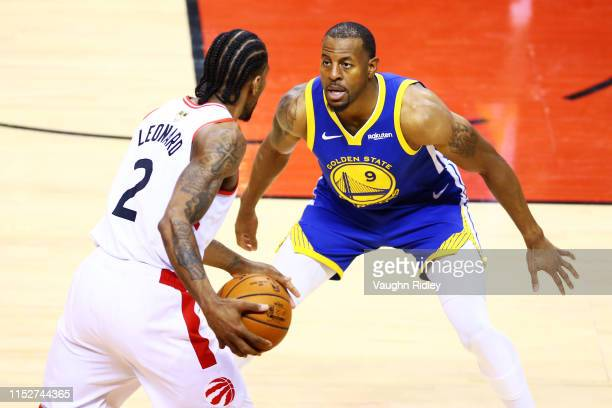 Kawhi Leonard of the Toronto Raptors Warriors is defended by Andre Iguodala of the Golden State Warriors in the second half during Game One of the...