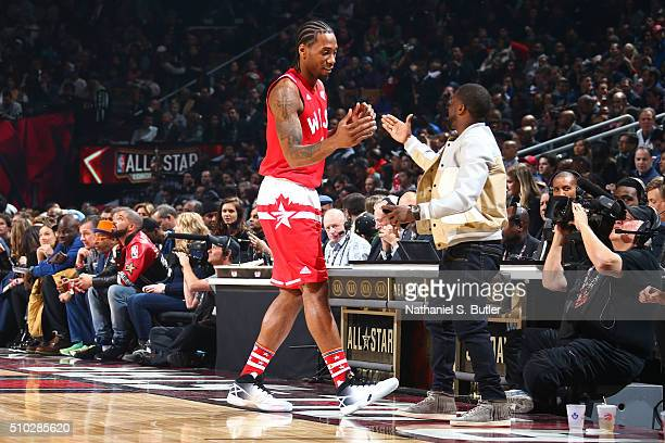 Kawhi Leonard of the Western Conference shakes the hand of Comedian Kevin Hart before the NBA AllStar Game as part of 2016 NBA AllStar Weekend on...