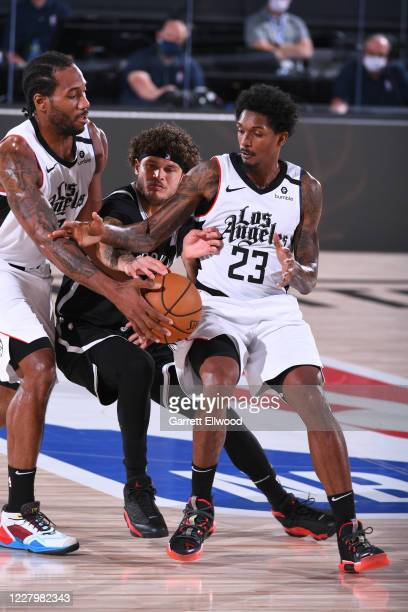 Kawhi Leonard passes the ball to his teammate Lou Williams of the LA Clippers during the game against the Brooklyn Nets on August 9 2020 at...